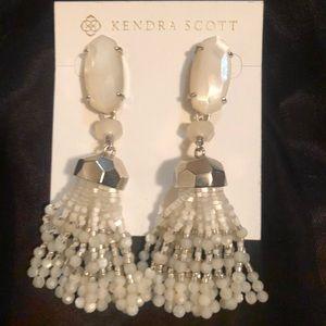 Kendra Scott Mother of Pearl Dove earrings.